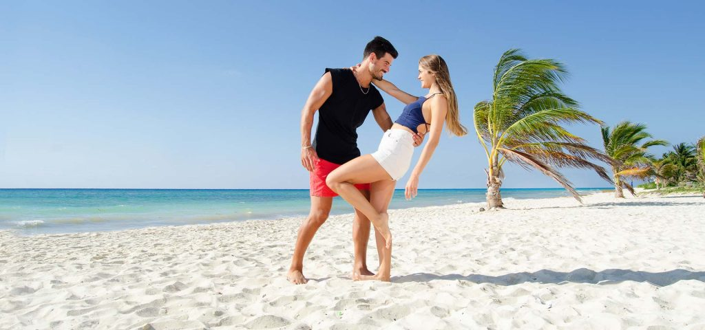 Romantic young couple on the Cancun beach