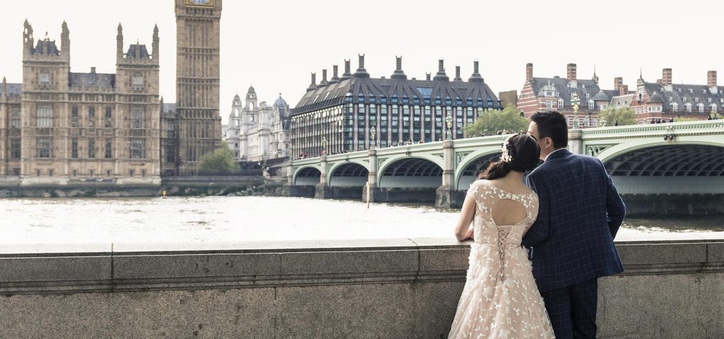 Bride & groom at Westminster bridge in London