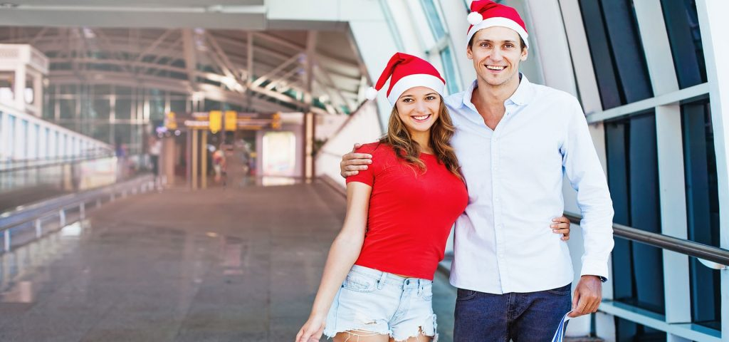A Couple Going to Abroad Celebrating Christmas