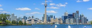 Toronto's skyline with CN Tower over lake in Canada