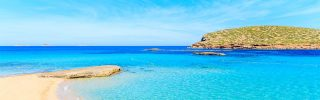 Sandy Cala Comte beach in Ibiza island, Spain