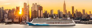 A large cruise ship sails Hudson river in New York