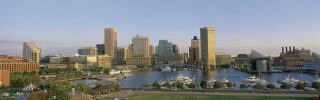 Baltimore in daylight showing the inner harbor and city lights